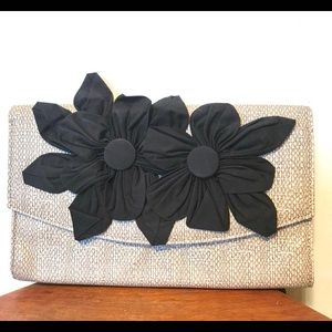Poppies Jones clutch with flower detail